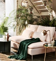 BritishStyleUK: 6 Spring trends from Sainsbury's Home. Pale blush pink sofa with dark green and gold brass accents.
