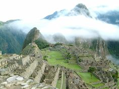 An overview of Machu Picchu, showing the pyramid outcrop that holds the Intihuatana