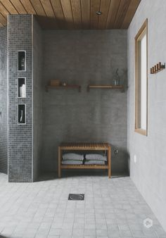 I like the set up of this shower. seat or bench on back wall, a small wall to the left that also has storage in the end, and longer wall to the right. open