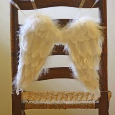 Angel wings for the flowergirls, attached to the back of their chairs...