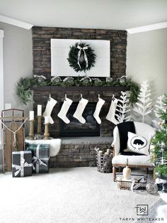 Recreate this Neutral Christmas Mantel using lush greenery, winter white and pops of black and plaid. This look is fresh, clean and festive.