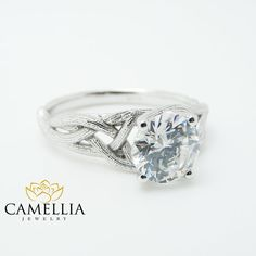 For impeccable style, you simply cannot go wrong with this branch moissanite engagement ring from Camellia Jewelry. Hand-forged in stunning detail, the mounting resembles a twisted branch from an enchanted forest as it elevates sparkling forever classic moissanite in luminous detail. Whether worn as a promise ring or an engagement ring, this 14K white gold twig ring symbolizes an everlasting love that will only ripen with age. This is an original Camellia Jewelry. Order now to guarantee…