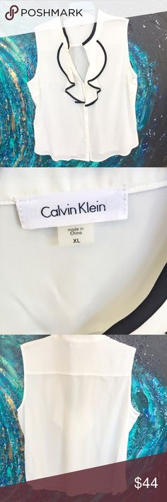 Chic day to night Calvin Klein sleeveless blouse Beautiful white sleeveless blouse with neckline ruffle detail in black. NWOT Never worn Calvin Klein Tops Blouses