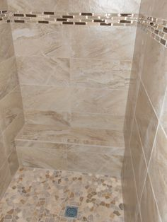 Vencil Homes - Bathroom #3 - Master Bathroom Shower - 12x24 tiles installed horizontally with a glass and stone liner bar.  #walkinshower #mastershower
