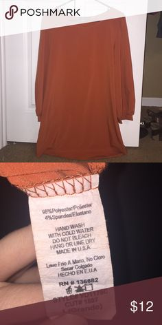 Burnt Orange Dress Beautiful dress in a burnt orange color. I love this dress so much but it just doesn't fit me. It's in excellent condition and the material is 96% Polyester and 4% Spandex. Feel free to ask me any questions you may have☺ The Vintage Shop Dresses Long Sleeve