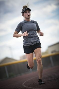File:U.S. Air Force Senior Airman Megan Stanton, a medic with the 366th Medical Operations Squadron, runs laps on the base track after a swi...