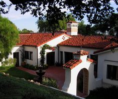 White washed stucco ground floor home with red roof tiles and courtyard. Jeff Doubet Design. Santa Barbara, California.
