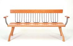 """""""Pitchfork Bench"""" cherry bench with found pitchforks and axe handles by Brad Smith."""