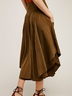 Free Falling Military Skirt | Super soft military-inspired skirt featuring a flowy shape and comfortable front pocket details. Thick waistband and rounded hem create an effortless fit. Hidden zipper closure. Fully lined.
