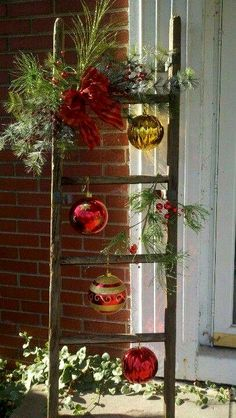 christmas ladder with glass ornaments maybe next to front door made with tree branches ummm i saw a couple of ladders left in my basement great idea