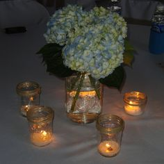 Simple but elegant wedding reception centerpieces with mason jars