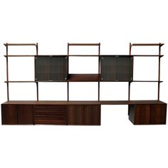view this item and discover similar shelves for sale at beautiful and large royal rosewood wall unit designed by poul cadovius and by cado