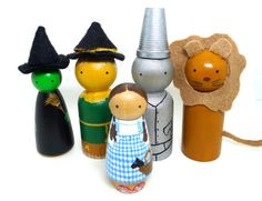This adorable wooden peg doll set includes the whole Wizard of Oz cast of characters. The dolls are about 2 tall. Dorothy is even carrying Toto.    Ideas
