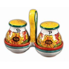 """6.5"""" x 5.5""""H  This hand-painted sunflower motif salt and pepper set bringscheerful Italian ceramic artwork to mealtime!Set your tablewith the oil and vinegar set, the napkin holder, andthe butter dish from this or with the sister styles from our other Umbria collections."""