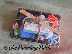 Nigiri Sushi Baby Gift Review | Parenting Patch: The Nigiri Sushi gift set from Yummy Baby Gifts is an adorable and unique gift to give to an expectant mother. Decorated and packaged to resemble Japanese sushi takeout, the gift set is a super cute alternative to more traditional diaper cakes. Plus, the washcloths and socks are incredibly practical for a new parent.