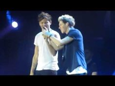 One Direction - She's Not Afraid, Manchester. Nouis, a missing microphone, thrusting, lyric changes, low voices, high voices, jumping off the stage, and Zarry. Perfect.