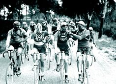 This photo from a 1920s Tour de France race shows the cyclists with spare tire tubes around their necks and lighting cigarettes.  At the time people believed that smoke provided a necessary jump start to the human body.   This is photo number two at the link.