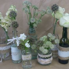 Wedding table decoration, bottles with hessian and lace