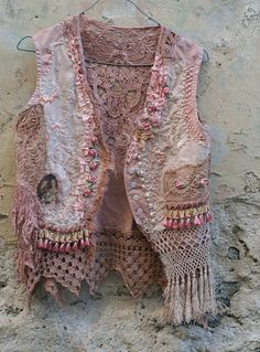 I admire Her work... it is creative... Small bohemian romantic vest with slightly asymmetric hem, made of linen, hand dyed in shades of sand, cream, blush; with most delicate and ornate