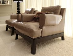 """TAYLOR lounge chair Materials:  Italian leather + Stained Oak Dimensions:   35.5""""W x 36""""D x 28""""H Options:  *Italian leather - please inquire as to other fabric and style options."""