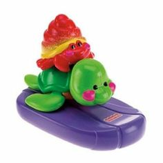 """Amazing Animals Tubtime Friends: Turtle and Hermit Crab by Fisher-Price. $7.15. A sweet sea turtle with a floating surfboard and a friendly hermit crab who's not at all shy are ready to make a splash in baby's bath! Turtle has clicking, movable joints and a cool surfboard to ride the waves of the tub. Hermit crab can be used as a cup for fill and spill fun. All pieces float and are easy to drain and keep clean. Measures 5.5"""" high stacked together."""