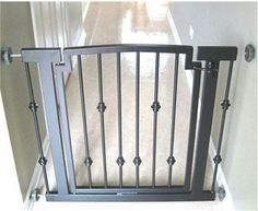 "Emperor Rings Hallway Dog Gate – The Pet Stop Emperor Rings Indoor Dog Gate is a designer, pressure mounted dog gate that is available in a black or mocha finishes. This uniquely designed pet gate features a walk through dog gate door, easily secured with a sliding bolt lock. The Emperor Rings pressure mounted dog gate is made of metal to prevent chewing.  ""Like"" or ""Pin"" this and use discount code ""Pin5"" for 5% off."