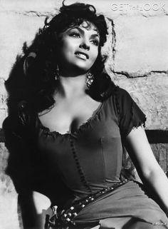 "Gina Lollobrigida strikes a pose in the film ""Notre Dame de Paris"" (1956) by Jean Delannoy."