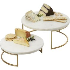 Gorgeous honed white marble floats effortlessly on a sculptural gilded base creating elegant stacked serving for parties, brunch and definitely holidays. Amazing housewarming/host gifts, too.Stainless steel stand with gold electroplated finish Due to natural material, color and veining will vary; each is unique Wipe clean