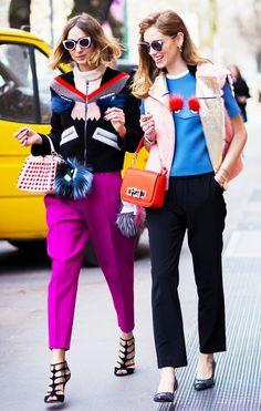 On Candela Novembre: Fendi sweater, fuchsia trousers, and black strappy heels; On Chiara Ferragni: Furry vest, graphic top, trousers, and flats