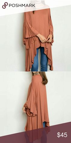 Boho Bell Sleeve Tunic Free People Inspired This tunic is a light rust color and features 3/4 bell sleeves, an asymmetrical hem, loose flowing fit, and a soft jersey like material. It is very versatile as it can be worn with jeans, leggings or over shorts with boots or cool shoes. It is similar to Free People in design and flowing, loose fit! It also runs big! Tops Tunics