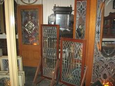 Unused Tiffany windows & doors in the Winchester Mystery House  Was amazing to see these just sitting there--love that place and want to return