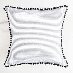 The Pom Pom Throw Pillows jazz up a classic accent pillow with a little pom pom punch. Made with 100% Linen and filled with a high quality poly insert, these don't just look great, they are super comfortable to lie on