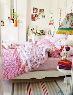 White walls with lots of color, love the duvet cover!