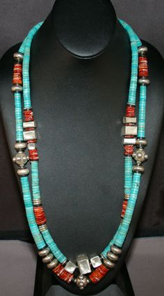 Double strand Turquoise and Spiney Oyster with Bali Silver and African Record Beads as accents. The longest strand is 32 inches long PayPal is accepted Artisan Made by ML Ranch Jewelry