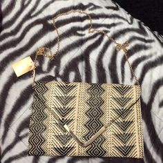 NWT Francesca's nude and black clutch Bamboo type material, gold hardware, removeable crossbody strap. Last picture is of my friend with the same clutch. Price is firm! Francesca's Collections Bags Crossbody Bags