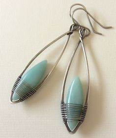 Silver and amazonite earrings by Aniko Sanders.  Click on Flickr to see more wonderful earring designs like this. Love the color and sleek shape.