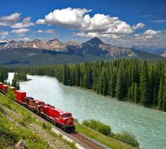 freight train moving along bow river in canadian rockies banff national park alberta canada Banff Canada, Alberta Canada, Banff National Park, National Parks, Trains, Rocky Mountain National, Train Journey, Canadian Rockies, Train Rides