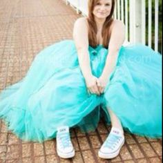 Converse with my prom dress! Yes I did that for both prom dresses! When I get married I will be wearing converse!