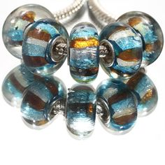 1x Blue Gold and Silver Striped Murano by MURPHYSTREASURES on Etsy, $1.25