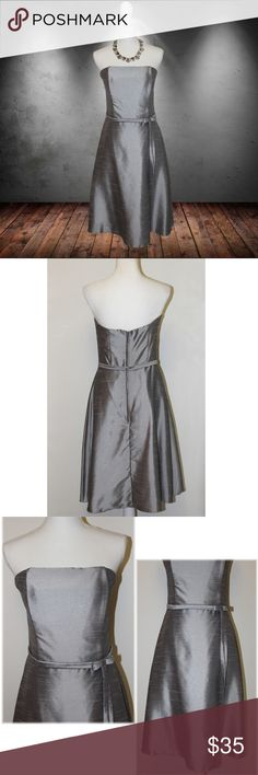 """Elegant Scott McClintock Strapless Dress This dress is so simple, yet so elegant.  * Color - Grey/Silver  * Fully lined * Back zip * Thin attached belt  * Fitted and flares * Shell - 64% nylon / 46% polyester  * Lining - 100% acetate  MEASUREMENTS   * Armpit to armpit (when fully extended) 16.5"""" * Empire waist 29"""" * Hips 42"""" * Length from mid-back 31.5""""  This dress by Scott McClintock is in very good condition, and is a size 10. Scott McClintock Dresses Strapless"""