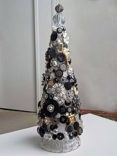 Beautiful Jeweled Table Top Christmas Tree! Crystals & Glass Beads & Buttons Watches & Brooches Faceted, shining, bright. An eclectic wonderful mix! Set on a glass base! With a glass & filigree metal tree topper! A lot of time, effort, and expense went into this little masterpiece! No one side or