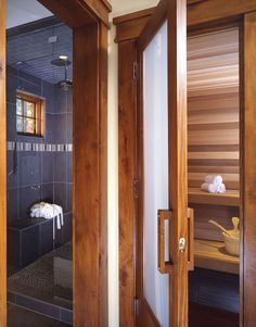 Shower and Sauna in this timber frame homes master bathroom. PrecisionCraft offers many award winning Timber Frame Homes Sauna Design, Cabin Design, House Design, Saunas, Bathroom Spa, Small Bathroom, Bathroom Photos, Bathroom Ideas, Sauna Shower