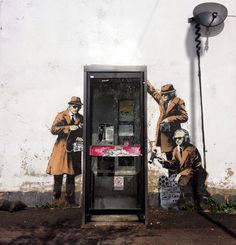 Banksy's latest works tackle technology, surveillance and our crumbling humanity