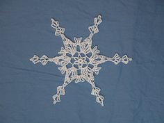 Decorate packages, windows, a tree or wreath with this fun and challenging snowflake. Connect multiple snowflakes together to create an elegant hanging ornament, and add a crystal bead and/or clear glitter paint for an extra touch. Or even connect several snowflakes with jump rings to create a beautiful garland. This pattern is included in the Fun & Fancy Flakes No. 3 pattern set. Skill Level: Intermediate.