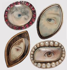 Antique lovers eye pendants.  Painted on ivory.