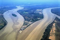 View from the north of the confluence of the Dordogne (left) and Garonne (right) rivers, forming the Gironde estuary, approximately 16 miles above Bordeaux, France, and 60 miles below the mouth of the Gironde at the Atlantic; in this view the legendary Right Bank is in the distance on the left, the Left Bank begins near the top right, and the Entre-Deux-Mers wine region begins in the middle region between the two rivers.