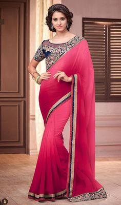 Express a new desire for elegance in this salmon and magenta color shade georgette sari. The wonderful attire creates a dramatic canvas with extraordinary lace, resham and stones work. #georgettesariscollection #womensari2015 #lovelysareedesign