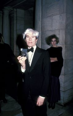 Andy Warhol in 1985  Turning the tables on the paparazzi at the CFDA Awards