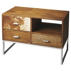 3-drawer chest with stainless steel legs and cowhide-inspired accents.   Product: ChestConstruction Material: Ma...