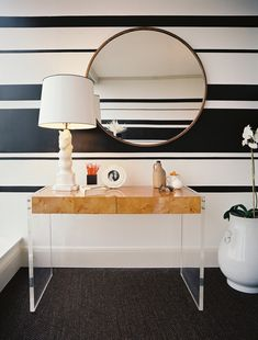 Without a budget for wallpaper in the guest bedroom of this Atlanta model condo, Lee Kleinhelter decided to apply a geometric stripe detail, which serves as the perfect complement to the modern furnishings.